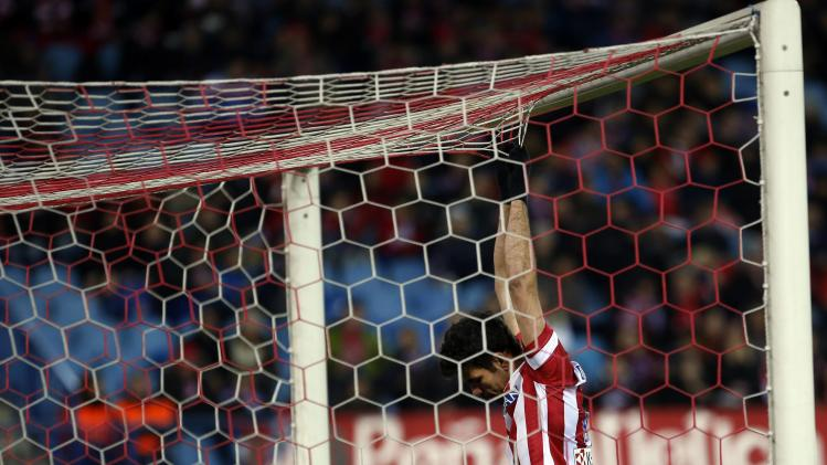 Atletico Madrid's Diego Costa reacts during their Spanish First Division soccer match after a missed scoring opportunity against Sevilla at Vicente Calderon stadium in Madrid