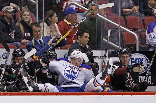 Edmonton Oilers center Connor McDavid ends up over the boards and into the Arizona Coyotes bench during the second period of an NHL hockey game Friday, Nov. 25, 2016, in Glendale, Ariz. (AP Photo/Ross D. Franklin)