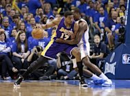 Los Angeles Lakers' Andrew Bynum (L) tries to get past Oklahoma City Thunder's Kendrick Perkins during game one of the NBA Western Conference series on May 14. Oklahoma embarrassed Los Angeles 119-90 in their NBA Western Conference second-round playoff series opener