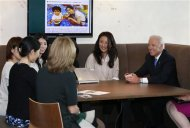 U.S. Vice President Joe Biden (R) and U.S. Ambassador to Japan Caroline Kennedy (4th L) meet employees of internet commerce and mobile games provider DeNA Co as they inspect the company headquarters in Tokyo December 3, 2013. REUTERS/Toru Hanai