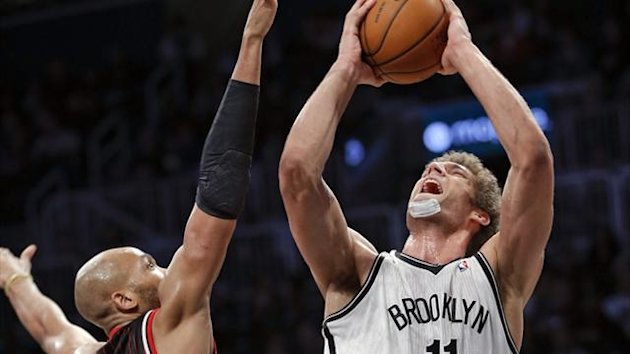 Brooklyn Nets center Brook Lopez (11) shoots past Chicago Bulls forward Taj Gibson (22) in New York (Reuters)