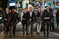 "In this film image released by Lionsgate, from left, James Colby, portraying Detective Mears, Barry Bradford, portraying Detective Benoit, Robert John Burke, portraying Captain Wolf, Jason Statham, portraying Luke Wright, Matt O'Toole, portraying Detective Lasky and Jay Giannone, portraying Detective Kolfax, are shown in a scene from ""Safe."" (AP Photo/Lionsgate, John Baer)"