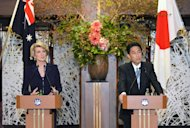 Australian Foreign Minister Julie Bishop (L) and her Japanese counterpart Fumio Kishida (R) hold a joint press conference after their meeting at the Iikura guest house in Tokyo on October 15, 2013