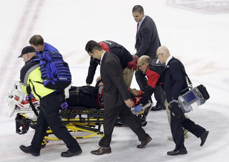 Carolina Hurricanes goalie Eddie Lack, of Sweden, is removed from the ice following an injury during overtime in an NHL hockey game against the Detroit Red Wings in Raleigh, N.C., Monday, March 27, 2017. Detroit won 4-3. (AP Photo/Gerry Broome)