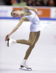 Polina Edmunds competes in the women's free skate at the U.S. Figure Skating Championships Saturday, Jan. 11, 2014 in Boston. (AP Photo/Steven Senne)