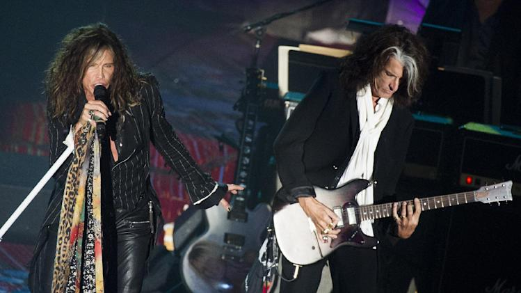 Inductees Steven Tyler, left, and Joe Perry from the band Aerosmith perform at the Songwriters Hall of Fame 44th annual induction and awards gala on Thursday, June 13, 2013 in New York. (Photo by Charles Sykes/Invision/AP)