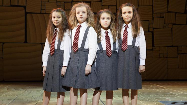 "This theater publicity image released by Boneau/Bryan-Brown shows the four actresses who share the title role in ""Matilda The Musical,"" from left, Bailey Ryon, Milly Shapiro, Sophia Gennusa, and Oona Laurence on stage at the Shubert Theatre in New York. (AP Photo/Boneau/Bryan-Brown, Joan Marcus)"