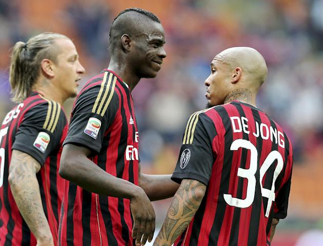 AC Milan forward Mario Balotelli, second from left, celebrates with his teammates Philippe Mexes, left, of France, and Nigel de Jong, of the Netherlands, after scoring during the Serie A soccer match