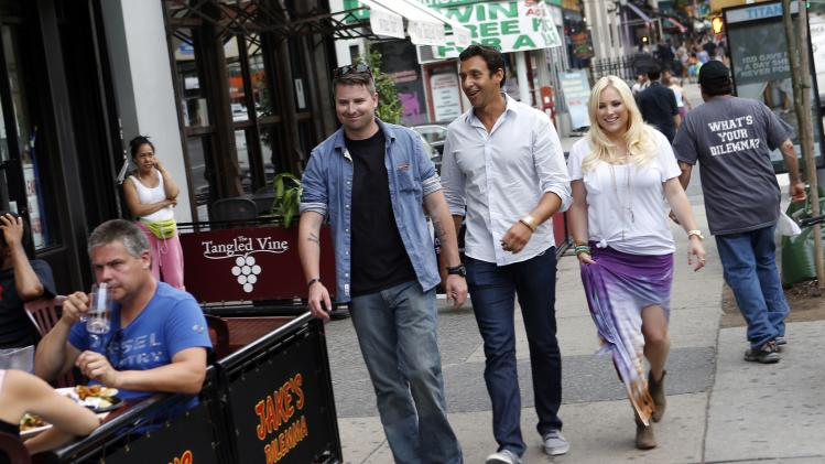 "This undated image released by Pivot shows, standing from left, Jimmy McCain, Kaj Larsen, and Meghan McCain in a scene from ""Raising McCain,"" a series following Meghan McCain, daughter of Sen. John McCain, premiering in September on Pivot. (AP Photo/Pivot, Jason DeCrow)"