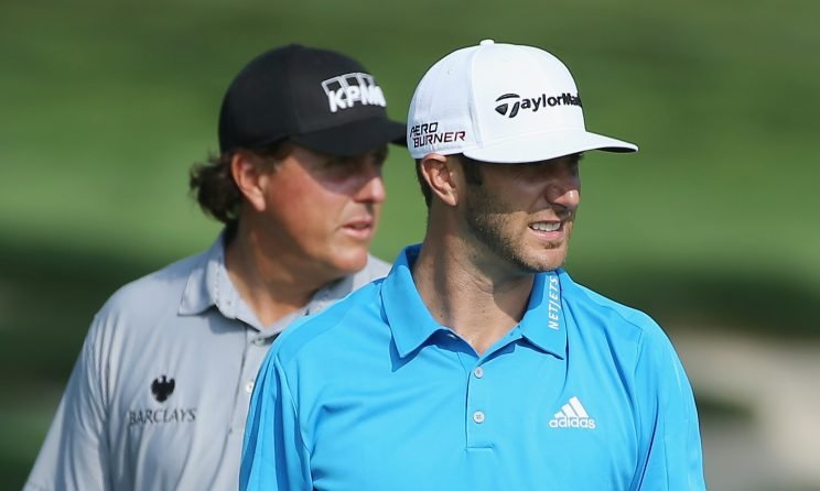 EDISON, NJ - AUGUST 25: Phil Mickelson and Dustin Johnson of the United States wait in a fairway during a practice round prior to the start of The Barclays at Plainfield Country Club on August 25, 2015 in Edison, New Jersey. (Photo by Scott Halleran/Getty Images)