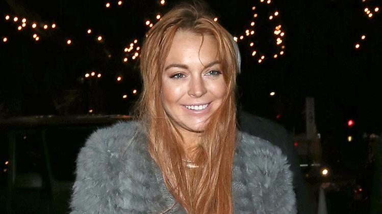 Lindsay Lohan returning to hotel after shopping at Harrods