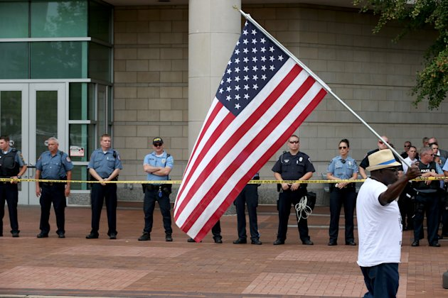 Police stand guard outside the entrance of the Buzz Westfall Justice Center in Ferguson, Missouri.
