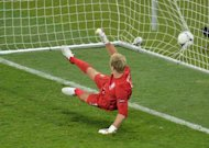 English goalkeeper Joe Hart watches the ball in his net scored by Italian midfielder Alessandro Diamanti during the penalty shoot-out at the Olympic Stadium in Kiev. England's penalty curse struck again here Sunday as Italy advanced to the semi-finals of Euro 2012 with victory in a shoot-out after a tense quarter-final duel finished 0-0 following extra-time