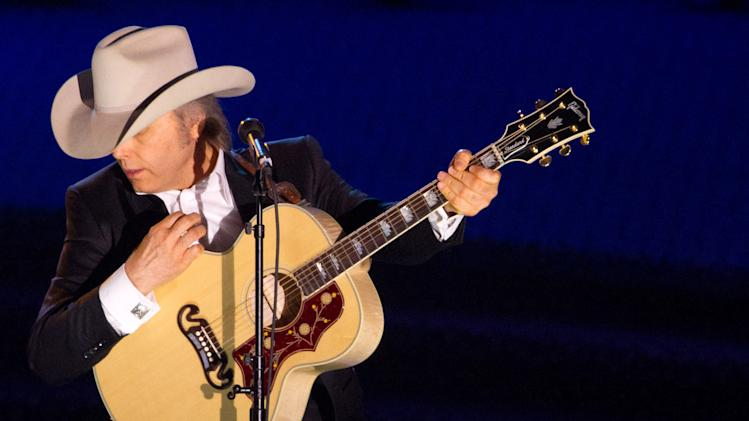 FILE - A June 16, 2011 file photo shows country singer Dwight Yoakam performing at the 42nd Annual Songwriters Hall of Fame Awards in New York.  Yoakam's first album in his return to Warner Bros. Records comes out Sept. 18, 2012.  (AP Photo/Charles Sykes, file)