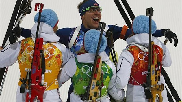 Norway's Ole Einar Bjoerndalen, Emil Hegle Svendsen, Tiril Eckhoff and Tora Berger (L-R) celebrate after crossing the finish line to win the mixed biathlon relay at the Sochi 2014 Winter Olympics (Reuters)