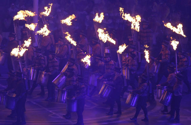 Performers carrying torches enter the Olympic Stadium during the closing ceremony for the   2012 Paralympics games, Sunday, Sept. 9, 2012, in London. (AP Photo/Kirsty Wigglesworth)