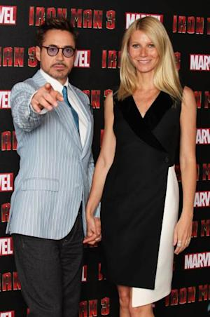 Gwyneth Paltrow and Robert Downey Jr attend a photocall for 'Iron Man 3' at The Dorchester Hotel on April 17, 2013 in London -- Getty Premium
