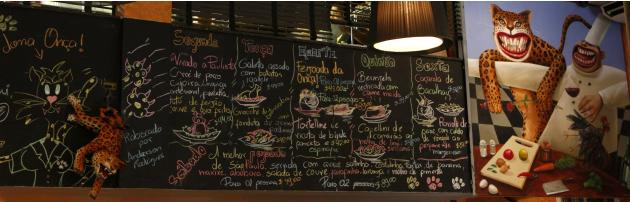 The menu of the Bar da Dona Onca restaurant is seen on the wall of the restaurant in Sao Paulo