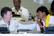 Bolivia's President Evo Morales and Colombia's President Juan Manuel Santos gesture during the closing ceremony of the Social Forum of Cartagena, ahead of Summit of the Americas