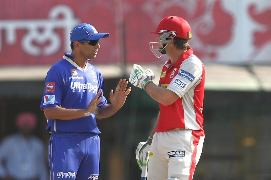 Rajasthan Royals captain Rahul Dravid tries to cool things down with Kings XI Punjab captain Adam Gilchrist after an allocation during match 55 of of the Pepsi Indian Premier League between The Kings