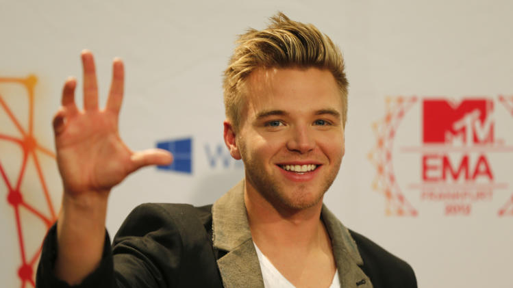 US actor Brett Davern poses for photographers during the 2012 MTV European Music Awards show at the Festhalle in Frankfurt, central Germany, Sunday, Nov. 11, 2012. (AP Photo/Frank Augstein)