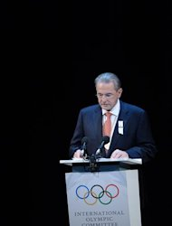 International Olympic Committee Jacques Rogge delivers a speech during the opening ceremony of the Internatinal Olympic Committee session, on July 23, 2012 in London, four days ahead of the beginnning of the London 2012 Olympic Games. AFP PHOTO MARTIN BUREAU