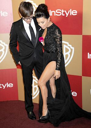 Eva Longoria Has a Nip Slip While Posing in Dress With Thigh-High Slit on Golden Globes Night