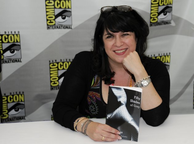 "EL James poses with her book ""Fifty Shades of Grey"" July 12, 2012 (Photo by Denis Poroy/Invision/AP"