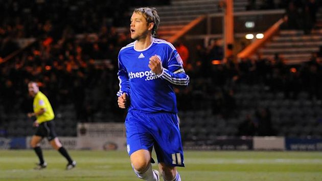 Peterborough United's Grant McCann celebrates