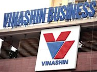 Logo of Vietnam's state-owned shipbuilder Vinashin group is pictured at its headquarters in Hanoi, in 2010. Former top executives at the Vietnamese shipbuilder whose huge debts shook investor confidence in the communist nation went on trial on Tuesday for defying state regulations