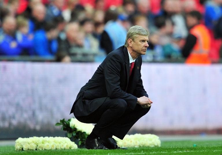 Arsenal's manager Arsene Wenger looks on from the touchline at Wembley Stadium in London on April 12, 2014