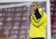 Chelsea manager Roberto Di Matteo mulls over a training session on the eve of the UEFA Champions League Group E football match against Nordsjaelland in Copenhagen