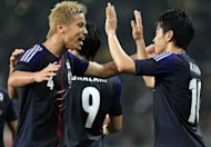 Japan's Keisuke Honda (L) and teammate Shinji Kagawa celebrate a goal during the football friendly against Azerbaijan on May 23. Japan are one of the 10 Asian teams left who are battling for four-and-half spots at the 2014 tournament in Brazil