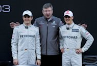 Mercedes Petronas F1 team drivers Germans Michael Schumacher (right), Nico Rosberg (left) and team principal Ross Brawn pose at Catalunya's racetrack in Montmelo near Barcelona in February 2012. Rosberg and his Mercedes team are confident of a strong showing in Canada next weekend - when a revived Schumacher could also be a major threat