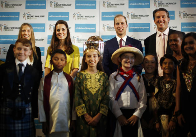 In this Wednesday, April 16, 2014 photo, Britain's Prince William, center right in the background, and his wife Kate, the Duchess of Cambridge, center left in the background, pose with children dr