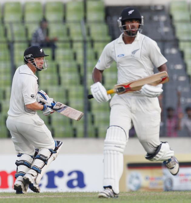New Zealand's Sodhi and Watling crun between the wickets against Bangladesh, during their third day of second test cricket match of the series in Dhaka.
