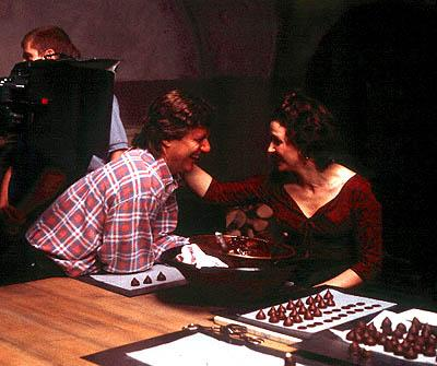 Director Lasse Hallstrom and Juliette Binoche on the set of Miramax's Chocolat