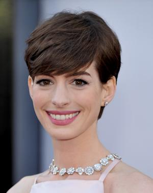 Actress Anne Hathaway arrives at the Oscars at the Dolby Theatre on Sunday Feb. 24, 2013, in Los Angeles. (Photo by John Shearer/Invision/AP)