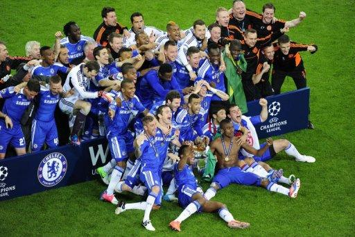 Chelsea players celebrate with the trophy