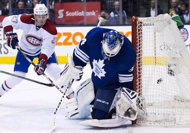 Maple Leafs goalie James Reimer allows winning goal to Canadiens forward Tomas Plekanec in Saturday's 4-3 loss
