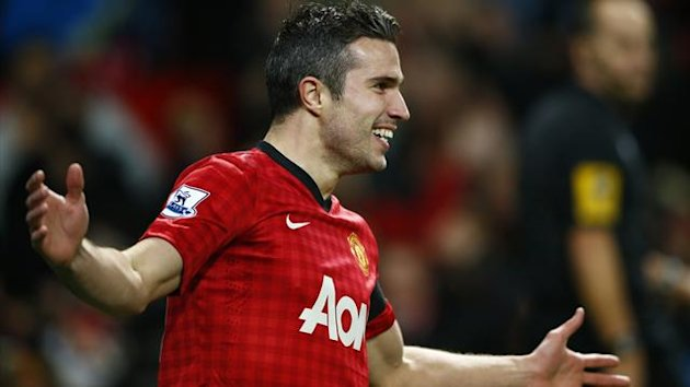 Manchester United's Robin van Persie celebrates his goal against West Ham United during their English Premier League match at Old Trafford in Manchester