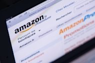 "An Ipad displays the ""Amazon"" web page. A German government minister has called for a thorough probe into allegations that foreign seasonal workers hired in Germany by US online retail giant Amazon were harassed and intimidated"