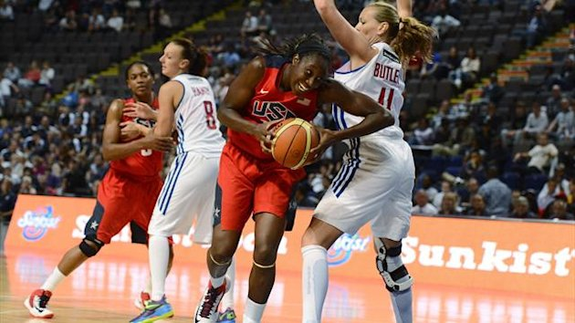 Kim Butler of Team GB (R) challenges Tina Charles of Team USA during their Olympic women's exhibition basketball game ahead of the London 2012 Olympic Games (Reuters)