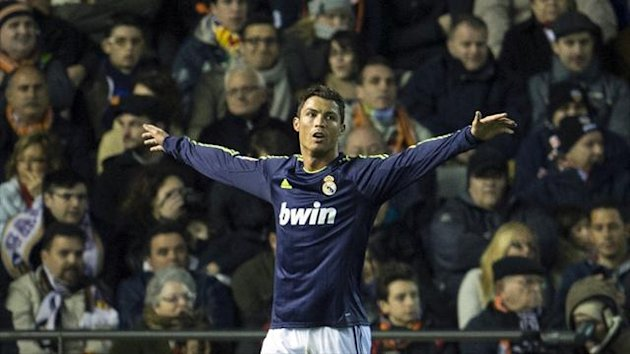 Real Madrid's Cristiano Ronaldo celebrates after scoring during the Liga match against Valencia at the Mestalla (AFP)