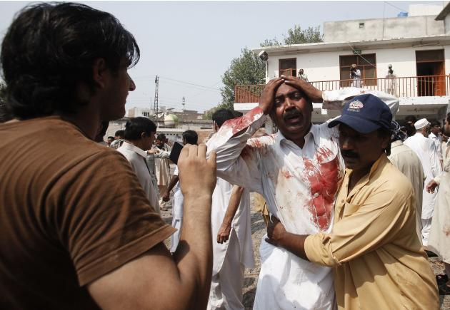 A man cries at the death of his brother at the site of a suicide blast at a church in Peshawar