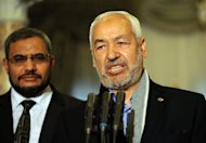 "Islamist ruling Ennahda party leader Rached Ghannouchi speaks to the press following his meeting with Tunisian President Moncef Marzouki on February 20, 2013, at the Carthage palace in Tunis. Ghannouchi said ""numerous parties have expressed their desire to be part of"" a new government"