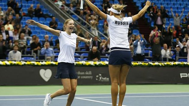 2013Russia's Elena Vesnina (R) and Ekaterina Makarova celebrate their victory over Japan's Misaki Doi and Ayumi Morita in their Fed Cup first round tennis match in Moscow February 10, 2013.