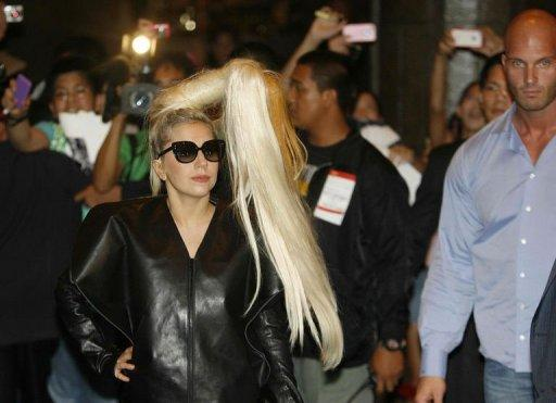 US singer Lady Gaga arrives at a hotel in Makati, financial district of Manila