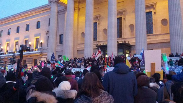 Hundreds of demonstrators gather in front of the Manitoba legislature for an Idle No More rally late Monday afternoon.