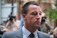 England footballer John Terry arrives at court in London on July 13. Roy Hodgson has called on his England stars to follow the example of Britain's Olympians and become better role models for their sport. In contrast, English football was tainted by the ugly revelations from Terry's successful court battle to prove he wasn't guilty of racially abusing QPR's Anton Ferdinand